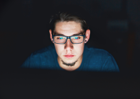 Guy with screen glare on his face