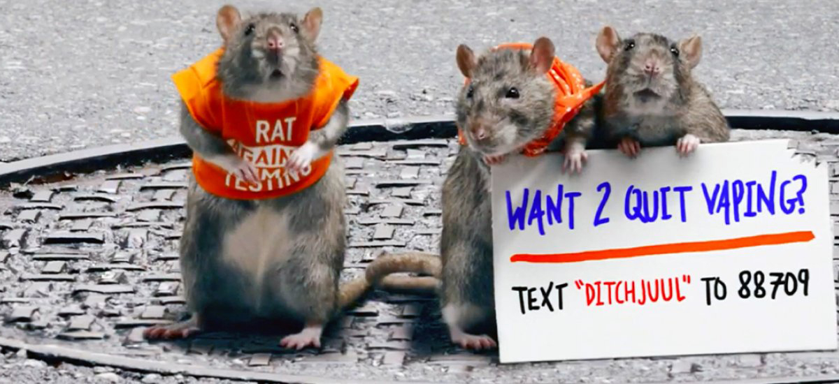 This is Quitting Rats holding ditchJUUL sign