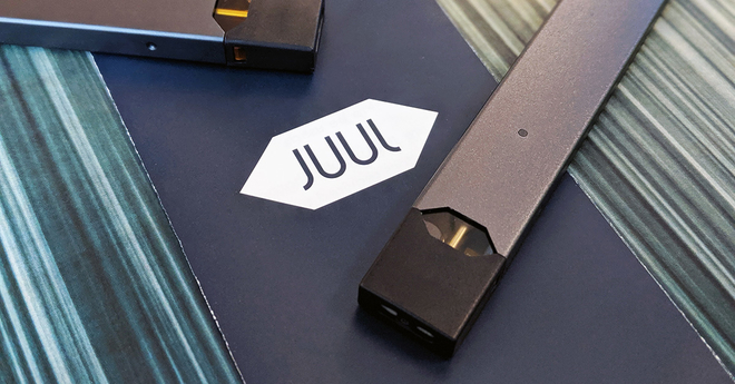 A JUUL on the JUUL Logo