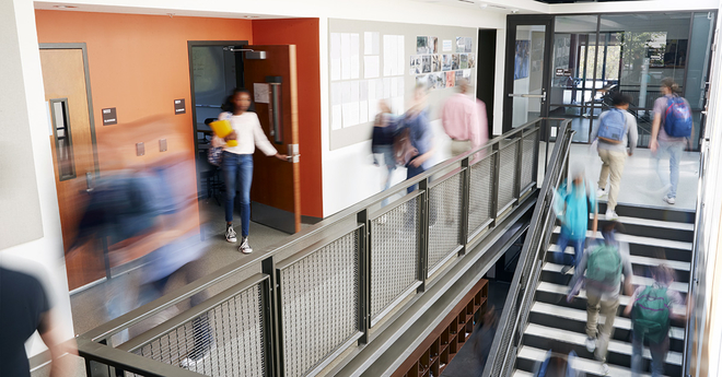 Image of a high school stairs and hallway