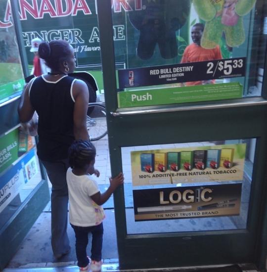 Retailer door with ads
